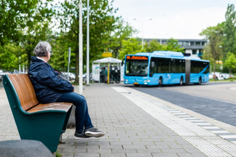 Woman is waiting for electric bus. Photo: Alex Schroder